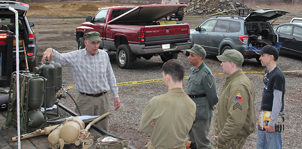 Author, left, training a group of potential operators at MA WWII Weekend in 2015.